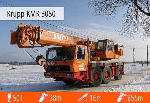 Doskonale znany żuraw Krupp KMK 3050 - specyfikacja techniczna, możliwości oraz zdjęcie w zimowej scenerii.